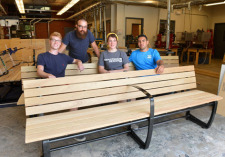 Industrial design students with bench project