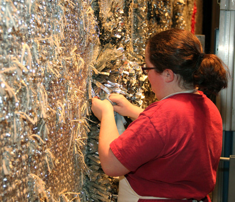 Undergraduate Amy Lowery Hand Cleans Mylar Strips In The Stephens Curtain.  Photo By Alex Murphy.