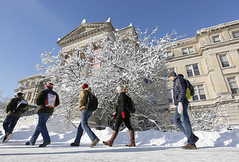 Students walk to class in the snow