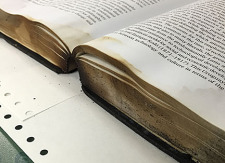 Water, smoke and fire damage to a book.