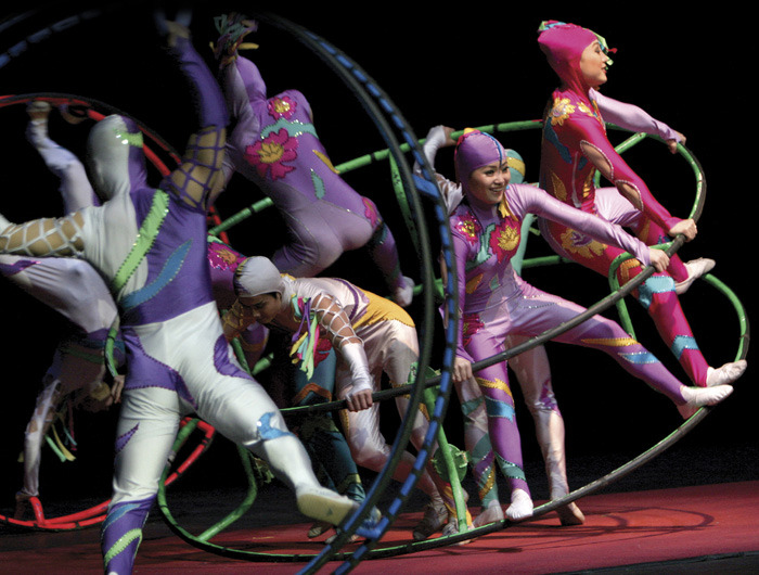 Acrobats in stunt involving large rings