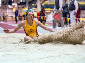 Kate Hall participating in the long jump.