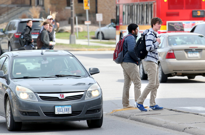 Pedestrians, cars mingle along Lincoln Way