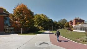Google street view of the sidewalk between the Jischke Honors Bu