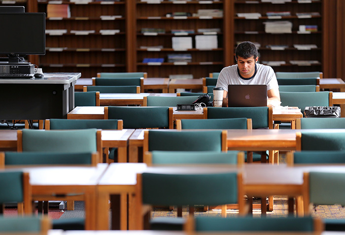 Male student studies alone in Parks reading room