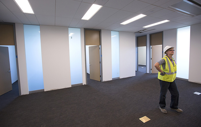 Project manager looks at empty office suite