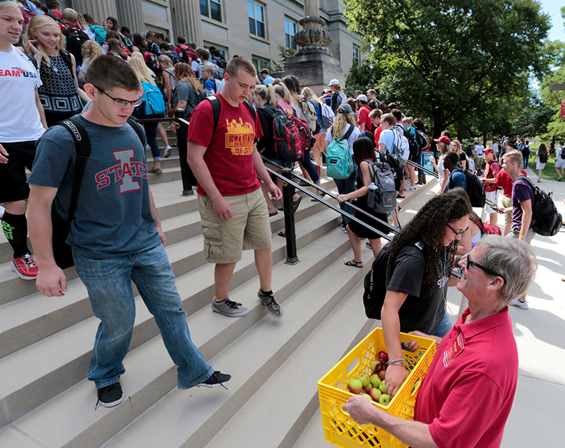Student ascend and descend the front stairs of Curtiss Hall