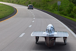 solar car trails a lead van on insterstate
