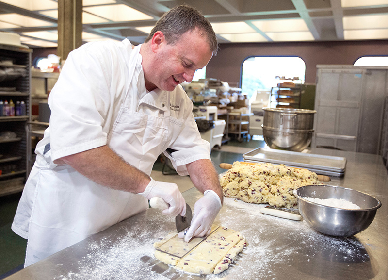 Pastry chef cuts scones by hand