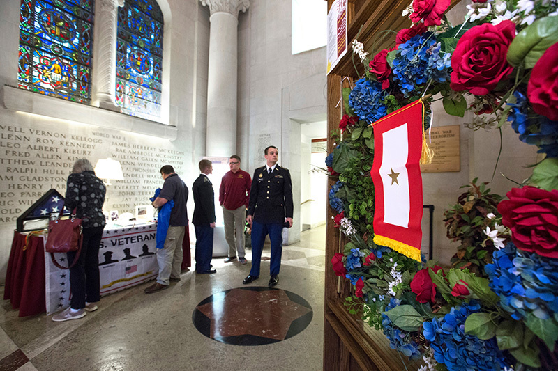 Visitors look over an exhibit in Gold Star Hall