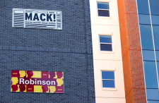 Two exterior signs on residence building read Mack and Robinson