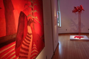 Red painting and red sculpture in exhibit hall