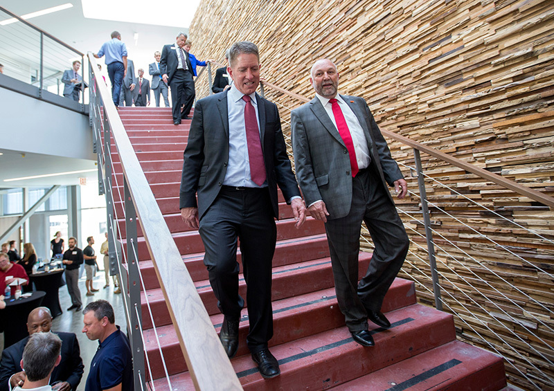 Bruce Rastetter and Steven Leath on the stairs of the Economic D