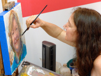 Female artist finishes up acrylic portrait
