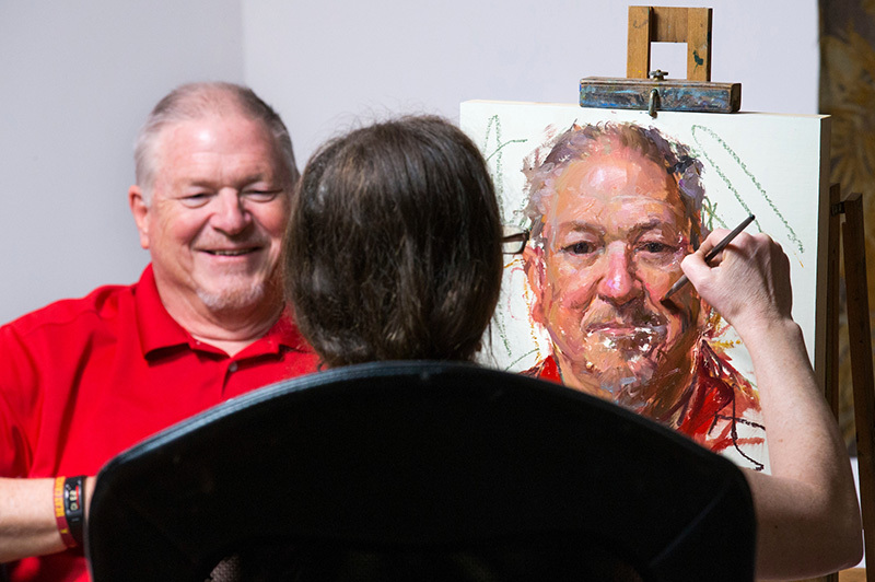 Man sitting for a portrait painting