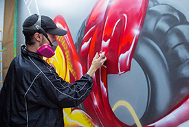 Tim Westrom paints a wall mural