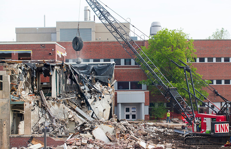 A wrecking ball is used to weaken the Nuclear Engineering Lab st
