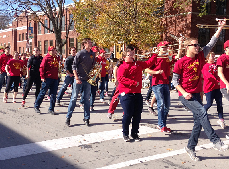 Cyclone band members march near city hall