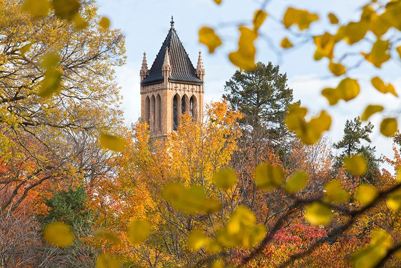 Trees sporting fall colors surround the campanile