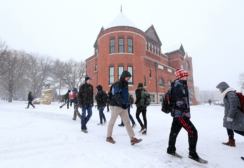 Walkers in the snow south of Morrill Hall