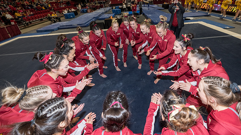 Iowa State gymnastics team huddle