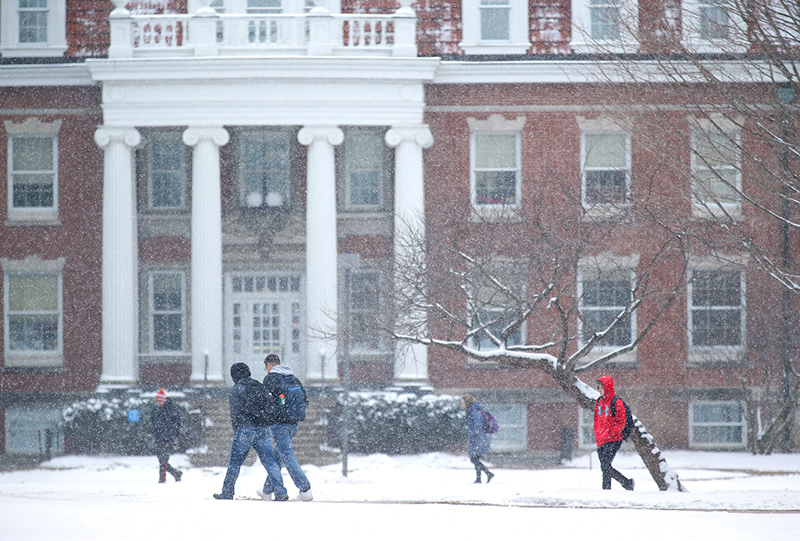 Snow falls on students near Enrollment Services Center.