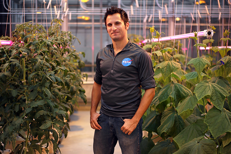Alex Litvin in a horticulture growth chamber