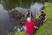Students launch a floating island on Lake LaVerne