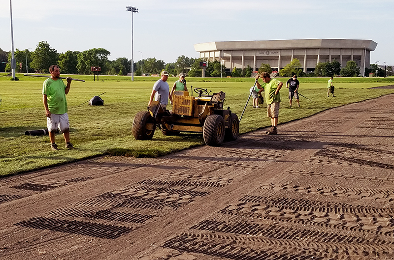 Crew lays sod on the east intramural field