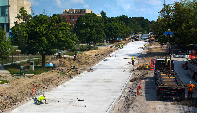 Crews work on a new Bissell Road surface