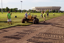 Crews lay sod on the MWL recreation field