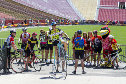RAGBRAI riders stop for a photo at Jack Trice Field.