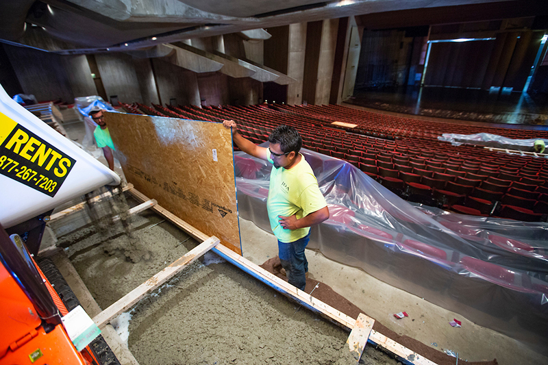 Two men pour concrete in Stephens to create a platform