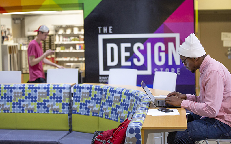 Design Store near study area with seated student.