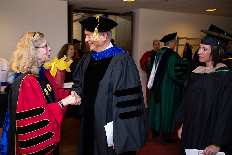 President Wendy Wintersteen, Faculty Senate president Peter Mart