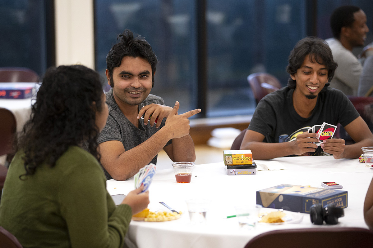 Photo of Sakhawat Saimon and others at community meal.