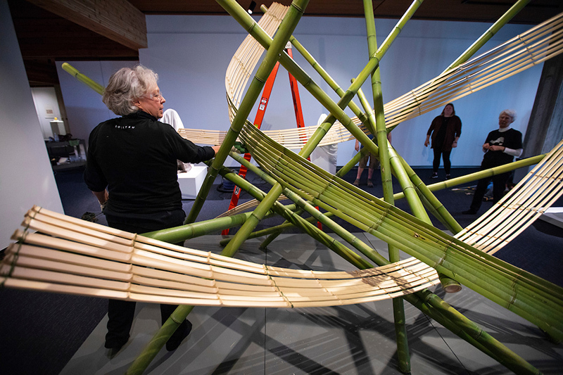 Marcia Borel adjusts a piece of bamboo