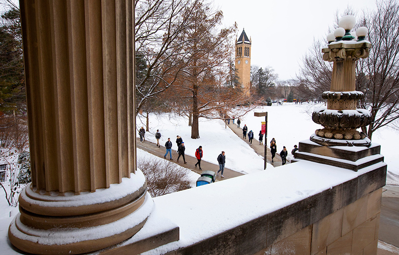 New snow covers central campus around the campanile