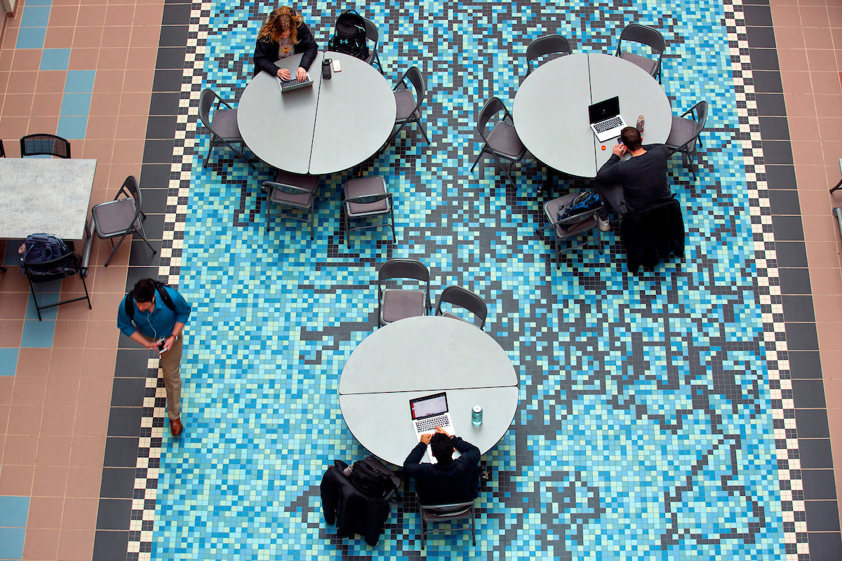 Students study on top of a mosaic floor in the Molecular Biology