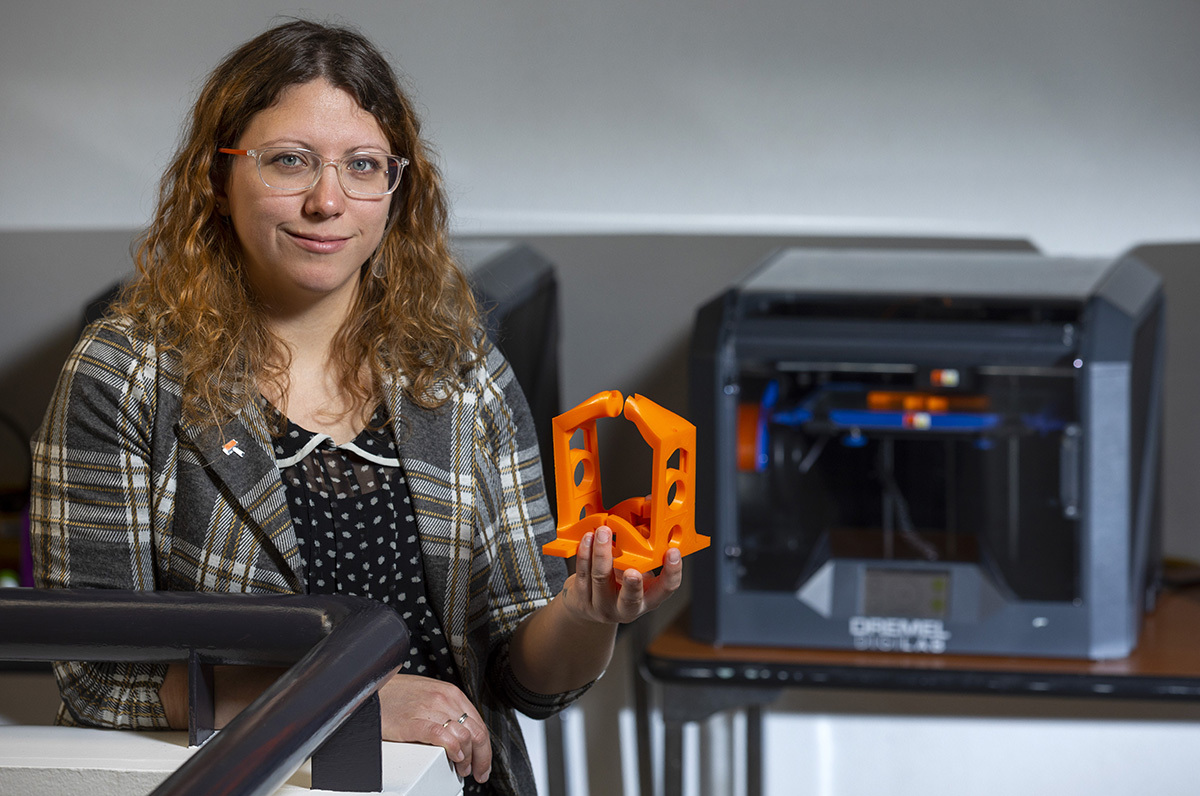 Raluca Iancu shows the 3D-printed mini press created for her pri