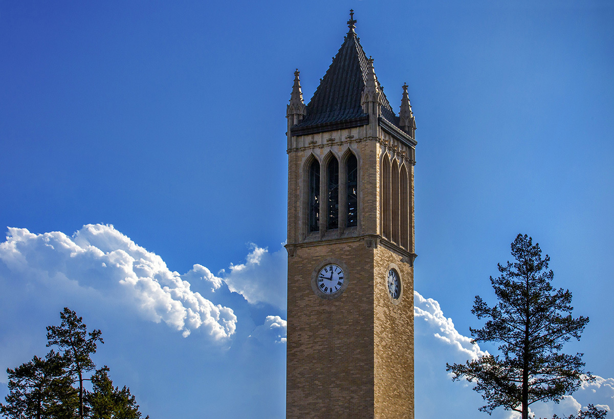 A view of the campanile with blue sky and clouds in the backgrou