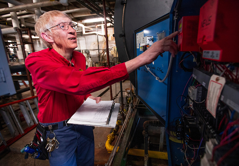 Mike Cleaveland checks a boiler control panel