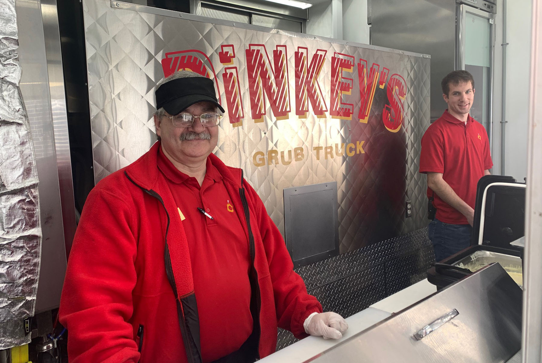 Food service managers in the Dinkey's food truck
