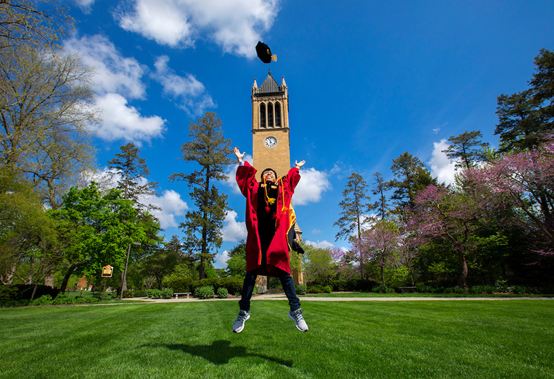PhD candidate Thanh Nguyen jumps for joy on central campus