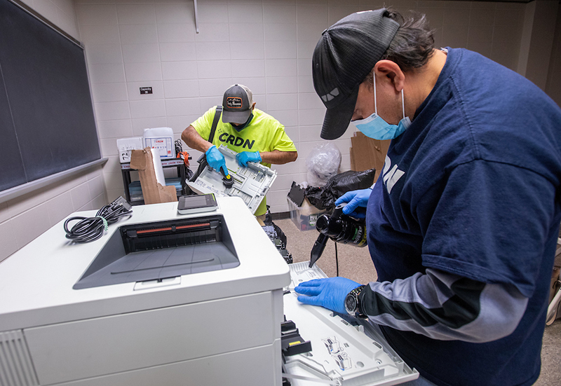 Specialists clean fire soot from printers